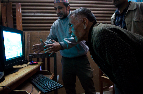 A CIC manager checks out new computers in Syangja district
