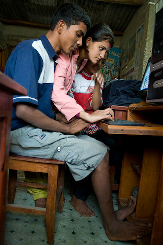 Nepali teens practice typing in Syangja